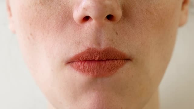 Woman eats strawberries. Mouth close-up. Front view. video