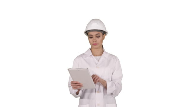 Woman engineer checking information and objects on her tablet on white background