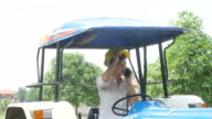 istock woman engineer using phone on tractor car 841931398