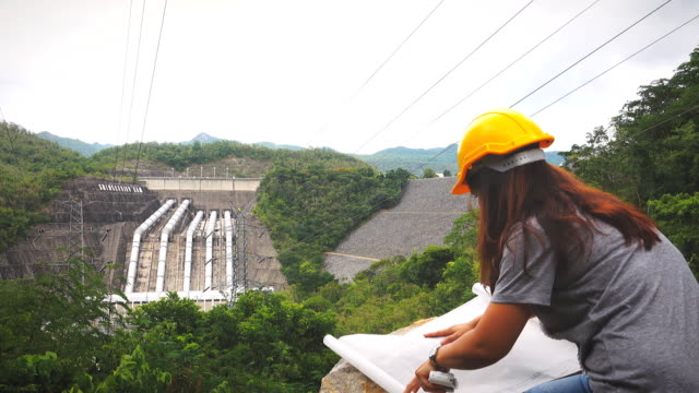 Woman engineer working at dam video