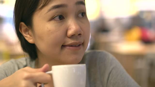 Woman enjoy drinking a coffee