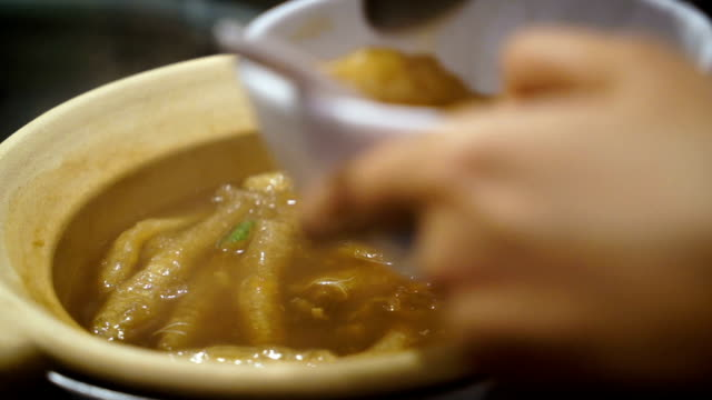 woman enjoy Fish maw soup in bowl video