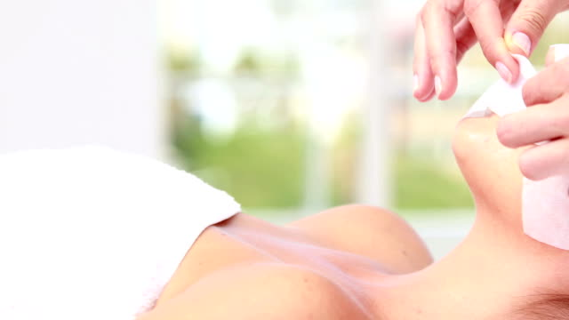 Woman enjoying a facial treatment video