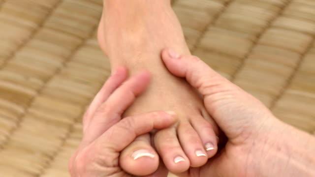 Woman enjoying a foot massage video