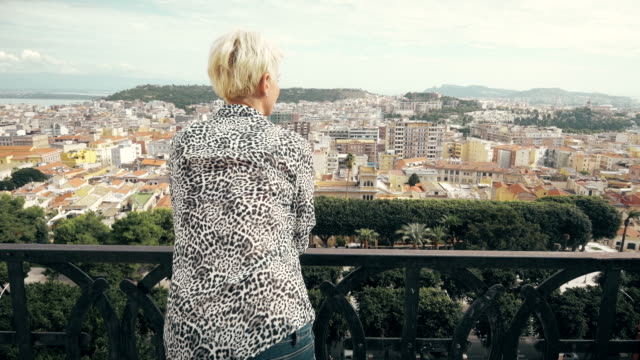 Woman enjoying Cagliari cityscape view video