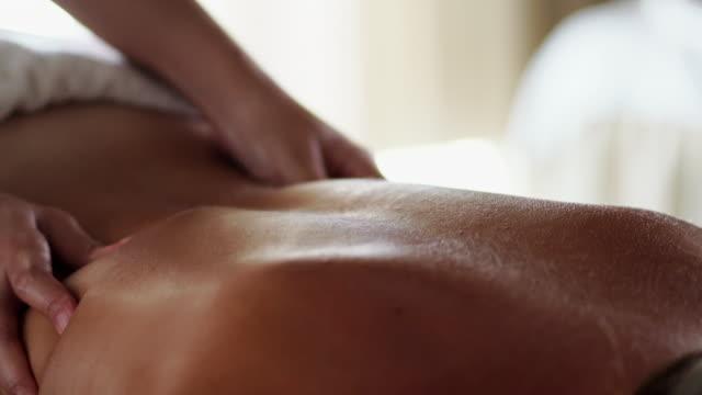 Video Woman enjoying her massage in spa