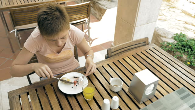 Woman enjoying lunch outside restaurant or cafe video