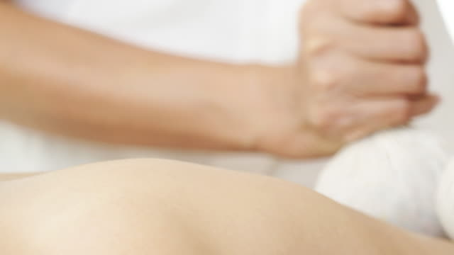 Woman enjoying massage for relaxation. video
