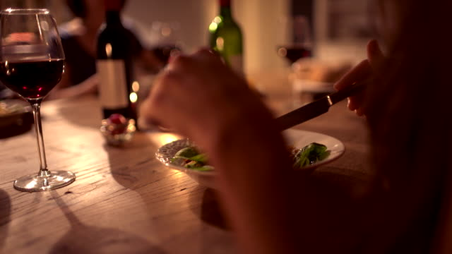 Woman enjoying plate of food at a dinner party video