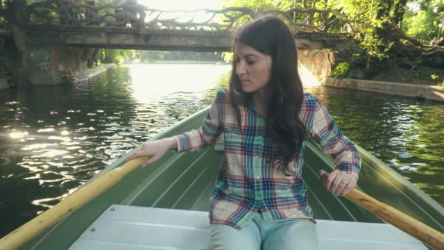Woman enjoying rowing. video