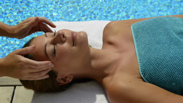 woman enjoying spa treatment-facial - spa facial stock videos & royalty-free footage