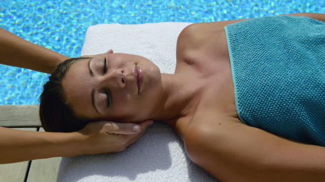 woman enjoying spa treatment-massage - spa facial stock videos & royalty-free footage