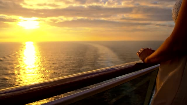 slo mo woman enjoying the travel at sunset - cruise video stock e b–roll