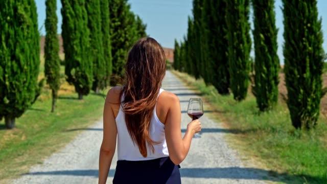 Woman Enjoying Tuscany in a cypress alley