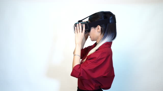 woman enjoying watching 3D simulation video from virtual reality (VR) headset - people and technology concept video