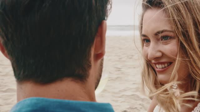 Woman enjoying wine with boyfriend at beach
