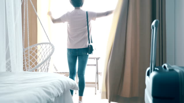 Woman enter the hotel with luggage