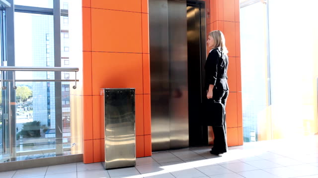 Woman enters into the elevator. video