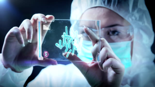 Woman examines sample demo on screen WOMAN THE SCIENTIST IS ANALYSING A Sample of YOUR demo. Screen is ready to tracking in postproduction.  molecular structure stock videos & royalty-free footage