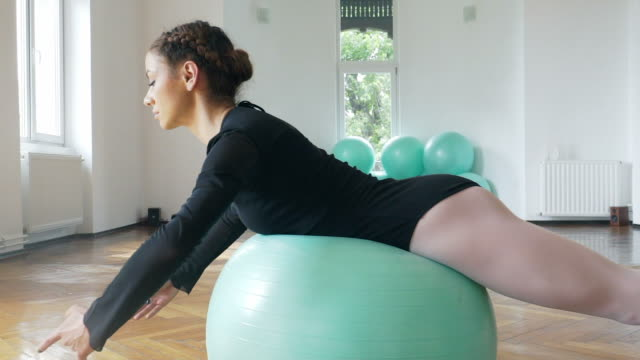 Woman exercising with fitness ball. video