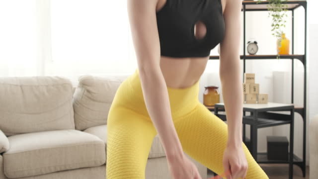 Woman exercising with resistance band at home video