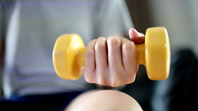 woman exercising with weights. video
