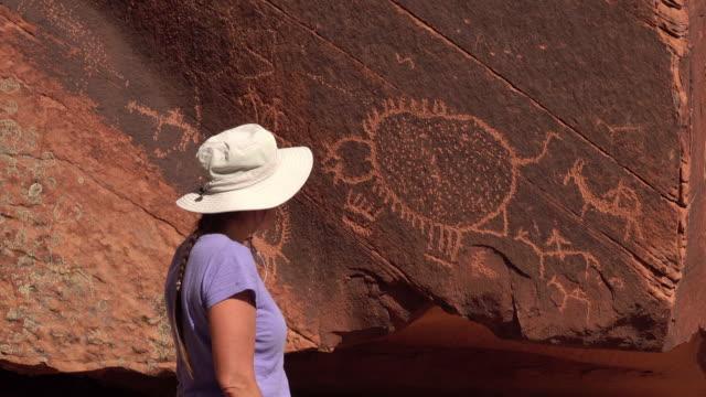 Woman explores Ute Native American petroglyphs Dominguez Canyon Wilderness Colorado video