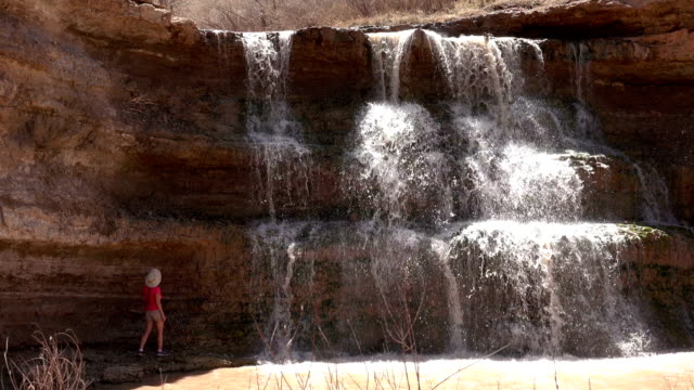 Woman explores Vermillion Falls waterfall Browns Park National Wildlife Refuge Colorado desert video