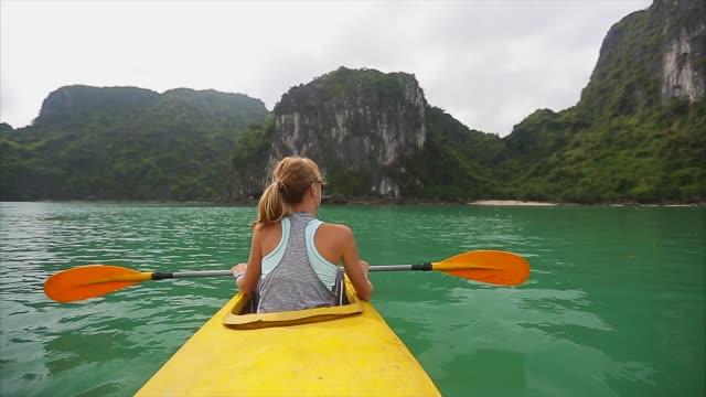 Woman exploring calm tropical bay video
