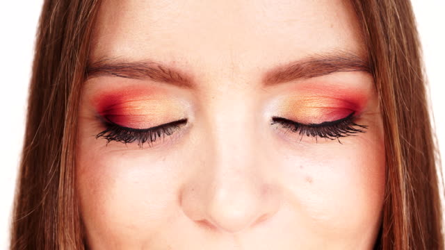 Woman face colorful eye makeup closed eyes closeup 4K Woman face colorful bright eye makeup closed eyes closeup. Summer holidays and happiness on white 4K ProRes HQ codec eyeshadow stock videos & royalty-free footage
