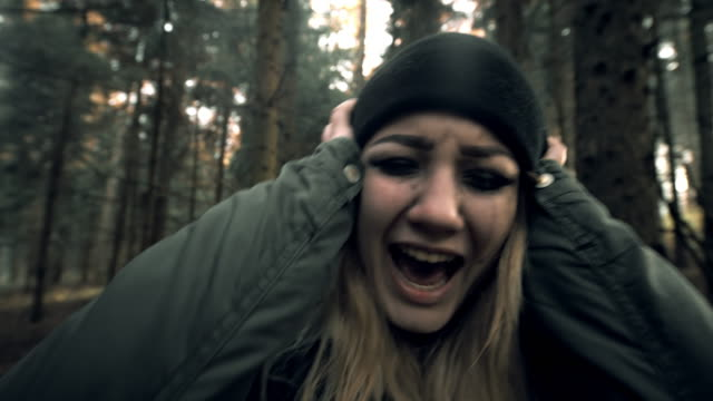 Woman fainting after having panic attack in the forest video