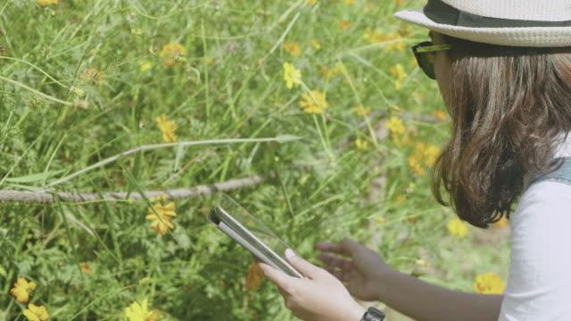 Woman farmer Checking video