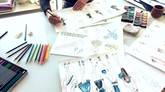 Woman Fashion Designer Drawing Ideas And Sketches Indoors Stock Video Download Video Clip Now Istock