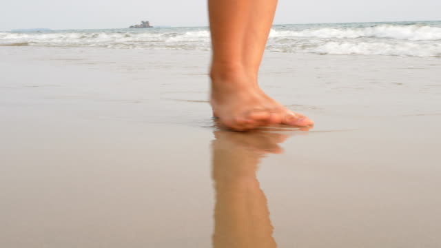 woman feet walking on the sand beach with the wave of the sea - gulf coast states stock videos & royalty-free footage