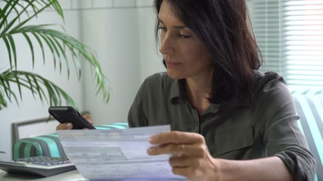 Woman Filling tax form Paying Bill on Smart phone, Mobile Payment
