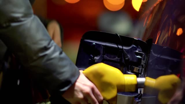 Woman fills gasoline car. Hand close up Woman fills gasoline car. Hand close up refueling stock videos & royalty-free footage