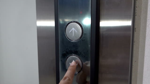 Woman finger presses the button for an elevator down Woman finger presses the button for an elevator going down push button stock videos & royalty-free footage