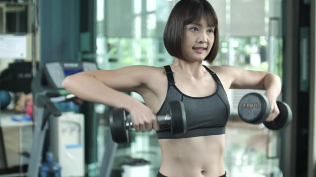 Woman Fitness woman working out with dumbbells at a gym video