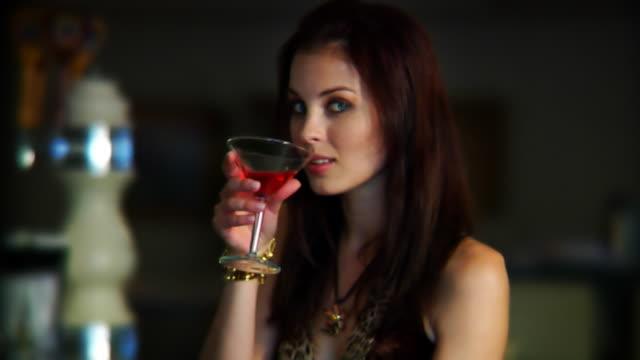 Woman Flirts at Bar