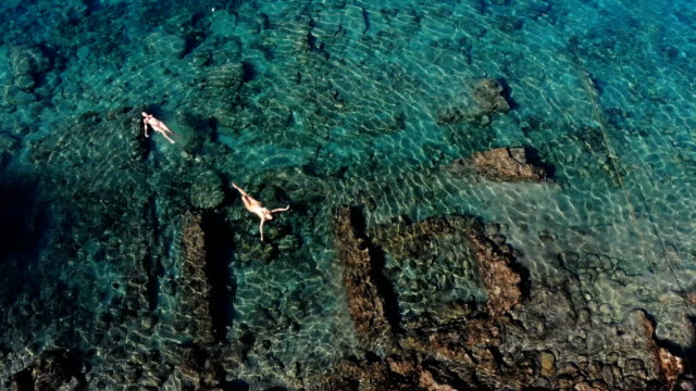 woman floating in sunken city. - fethiye video stock e b–roll