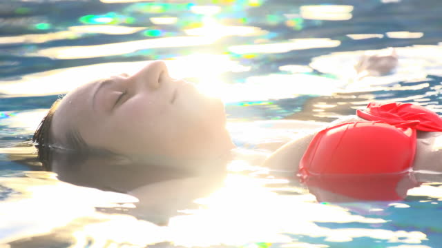 HD SLOW MOTION: Woman Floating In Water video