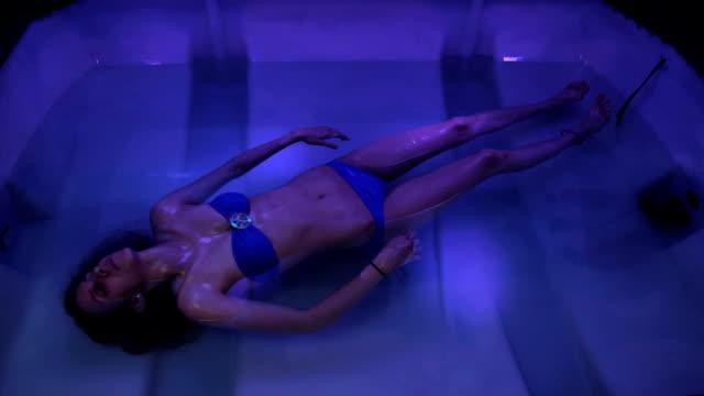 woman floats sensory deprivation tank video