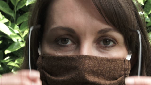 Woman Fogs Up Glasses While Wearing Face Mask
