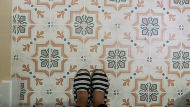 POV of woman foot while walking across retro tile pattern POV of woman foot while walking across retro tile pattern tile stock videos & royalty-free footage