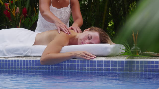 Woman gets back massage at spa video