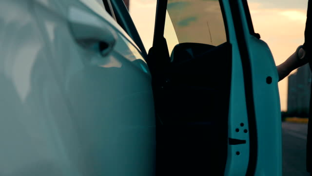 woman getting into the car - entrare video stock e b–roll