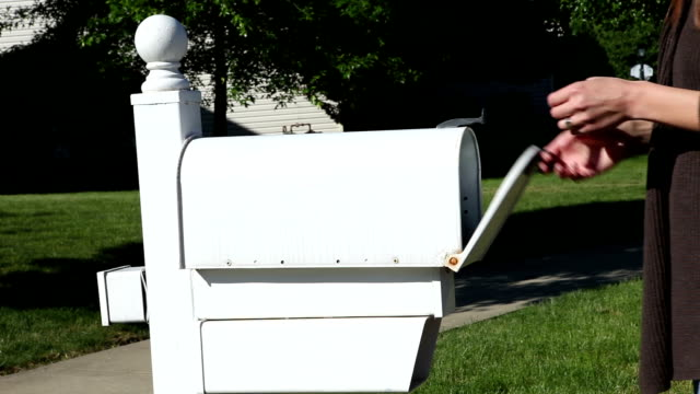 Woman Getting Mail From Mailbox video