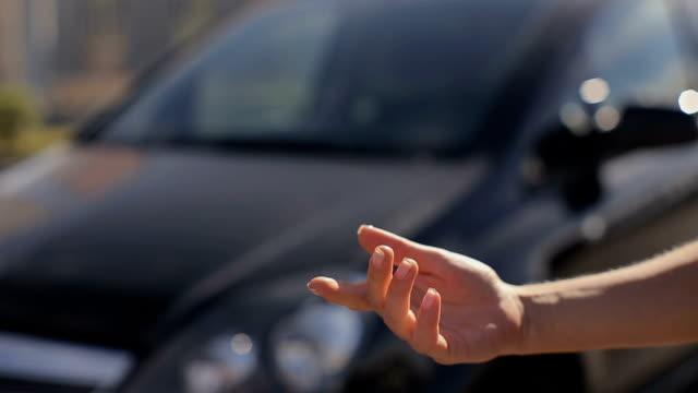 Woman getting new car keys of a black car. video
