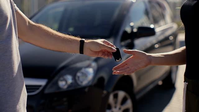 Woman getting new car keys. video