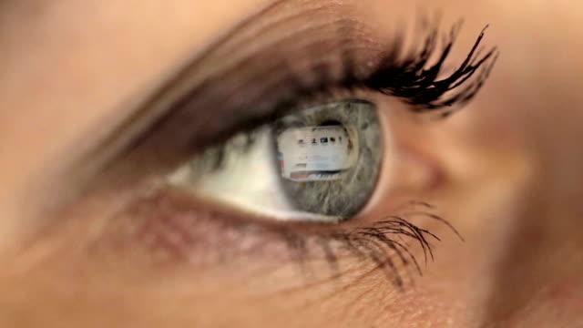 Woman girl eye looking monitor, spends surfing Internet Macro shot video